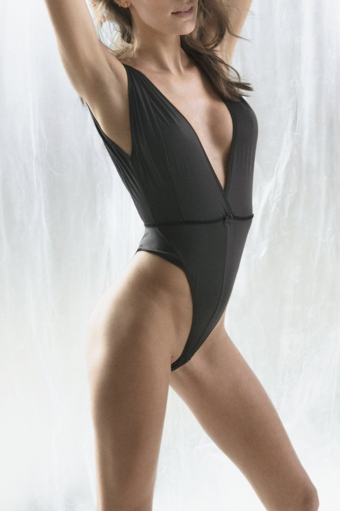 woman wearing a black sexy bodysuit from C. Leonor lingerie brand