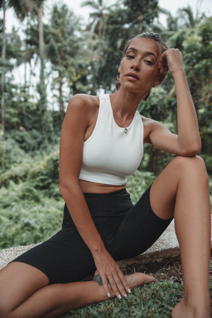 LÉ BUNS sustainable brand woman wearing their black bike shorts and white top