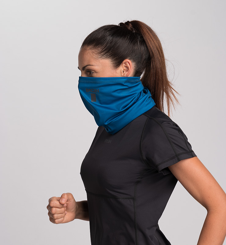 Girl wearing a CASA GIN - BUFF TEAL in her mouth and neck