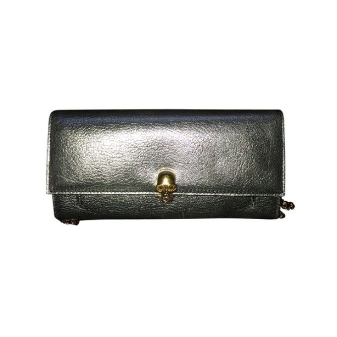 Alexander McQueen Silver Skull Clutch to find at Style Tribute and check it at veragallardo.com site