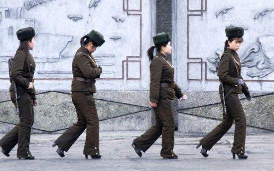 Female North Korean soldiers patrol along the banks of Yalu River