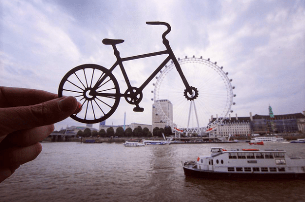 London Eye seen through a bicycle wheel