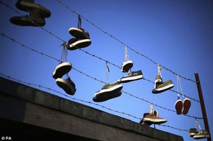 Old skate shoes strung from a fence at Rom skatepark in Hornchurch which dates back to the 1970s