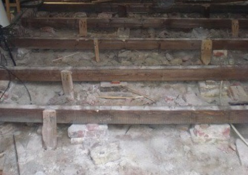 Houten vloer vervangen door een betonvloer  Verbouwkosten
