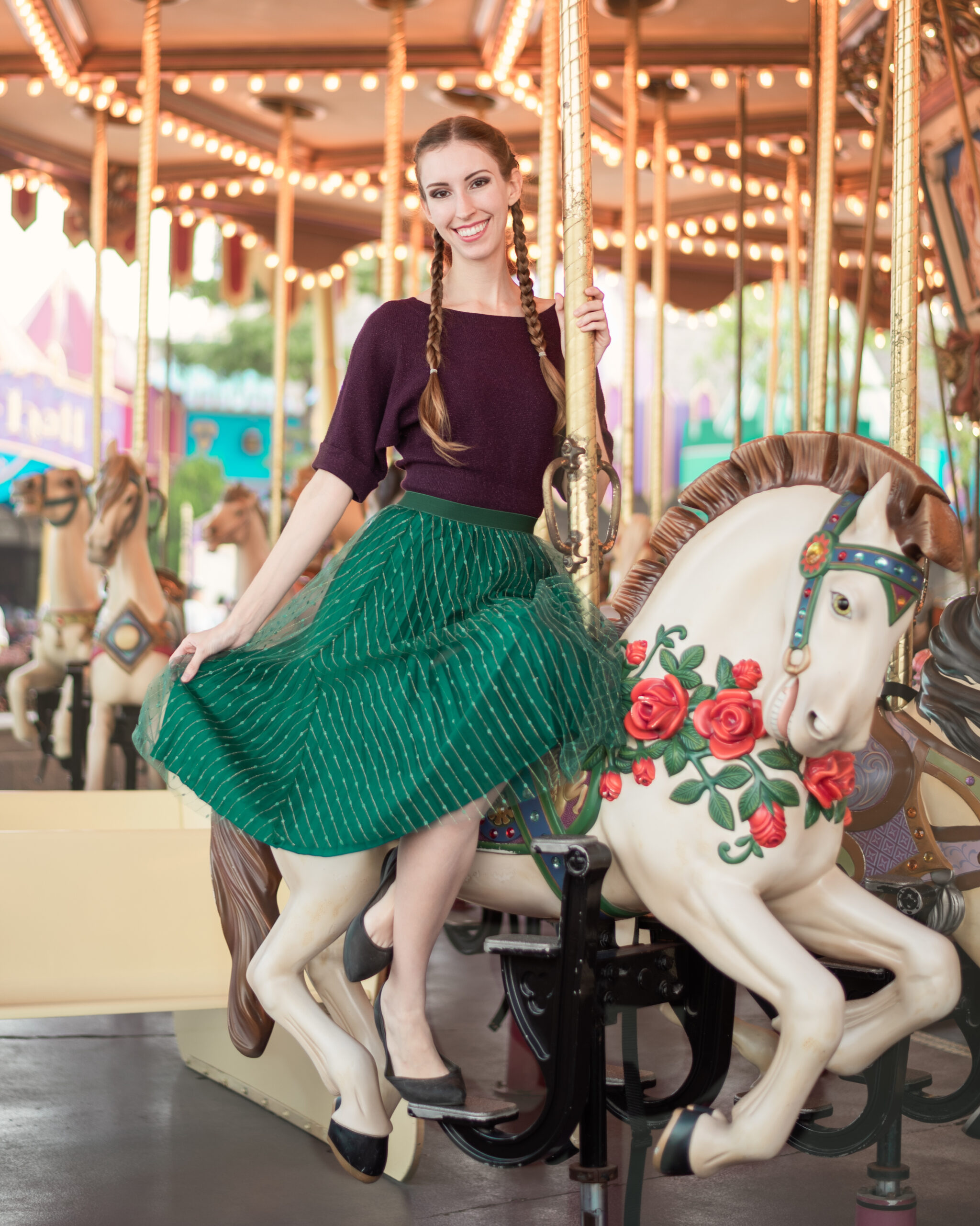 Travel portrait of Ellie wearing sustainable fashion on one of her verdant adventures in nature | Carousel at Hong Kong Disneyland