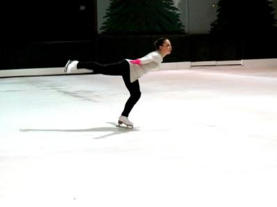 Junior Maya Ben-Efraim performs an arabesque on the outdoor ice skating rink at the Winter Lodge.