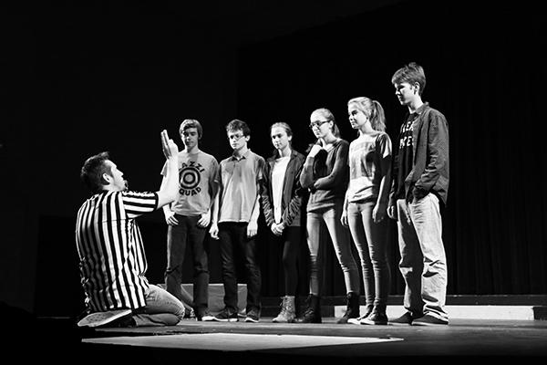 The PALY ComedySportz troupe prepares to play a game of Celebrity Pun-ishment, where they make puns out of a celebrity's name. Aaron Slipper, alum of PALY, was mentioned during the game.