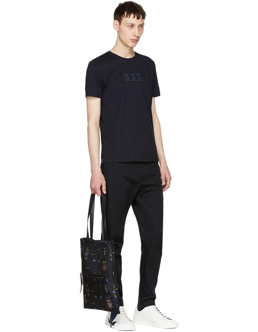 3abdb930 FENDI White & Navy Leather 'Bag Bugs' Sneakers · VERGLE