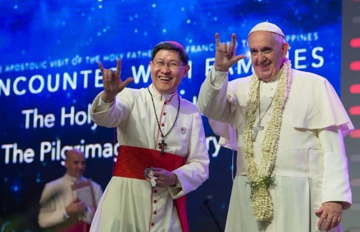 Pope Francis and Cardinal Tagle of Manila, flashing the horned hand signal during the pope's recent visit to Manila, Philippines.