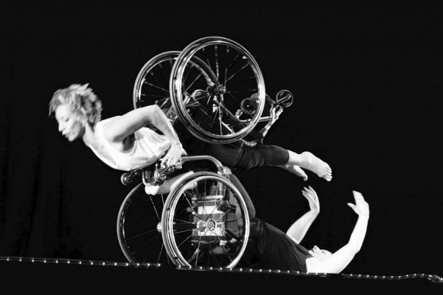 Two women dancing in wheelchairs