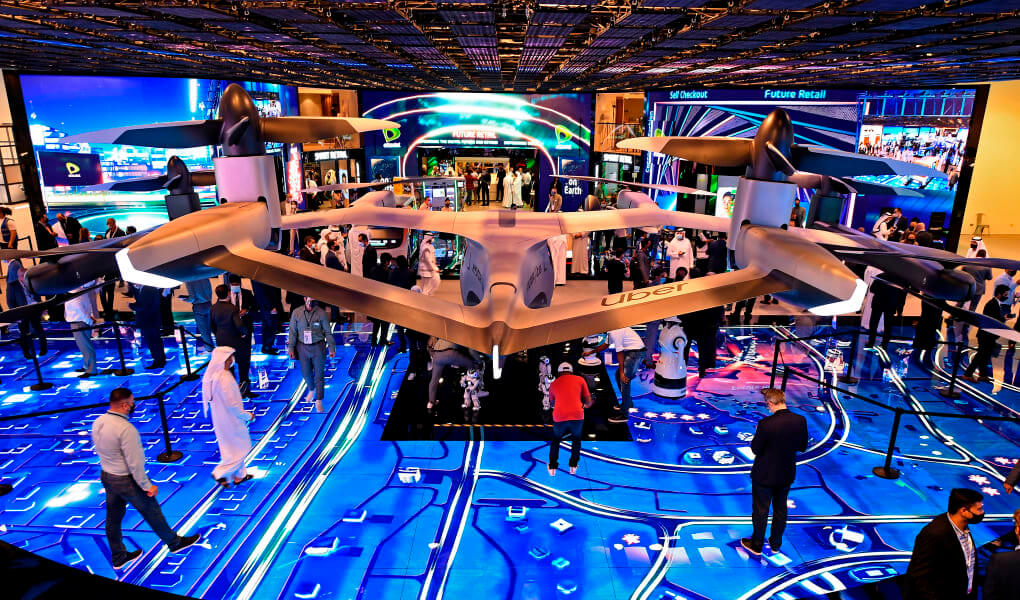 Visitors look at the flying concept car at Dubai Trade Centre during the GITEX 2020