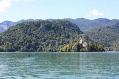 A view of the small island from a boat. The island has a Christian church. Temples in the story look roughly like this.