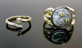 Meteorite and green gold hers & hers wedding rings.
