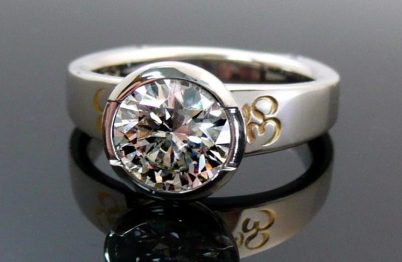 Hindu inspired custom CAD created platinum and diamond ring with 24K yellow gold accents.