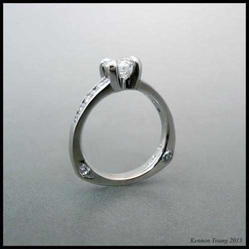 Custom CAD diamond platinum engagement ring with tiger prongs and a european shank.