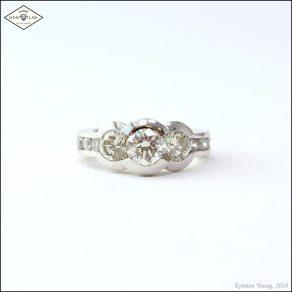 Three stone diamond engagement ring in platinum