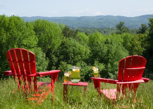 red adirondack chairs summer winds patio sit back and enjoy the view with our polywood