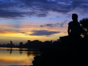 woman-praying-at-sunrise