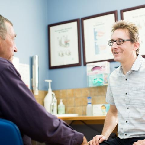 Tyler Perrault, Denturist, with a patient