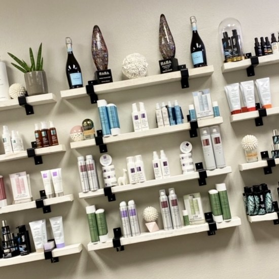 hair products on shelves in Plano hair salon