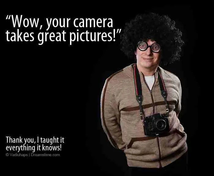 """Nerd wearing a camera with the quote :Wow. Your Camera takes great pictures. Thanks. I taught it everything I know!"""""""