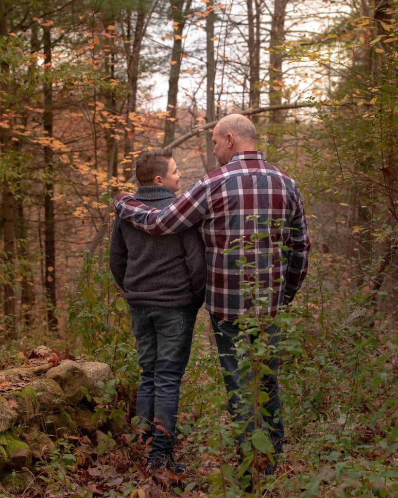 dad and son looking at one another using the wisdom photography prompt for families