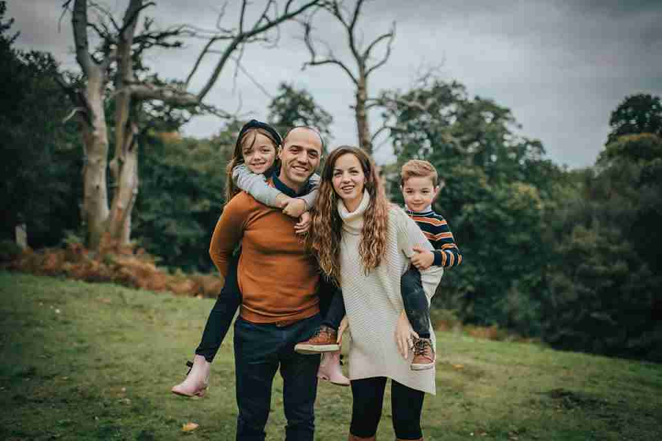 mom and dad giving 2 kids piggyback rides using piggyback ride Photography Prompt for Families