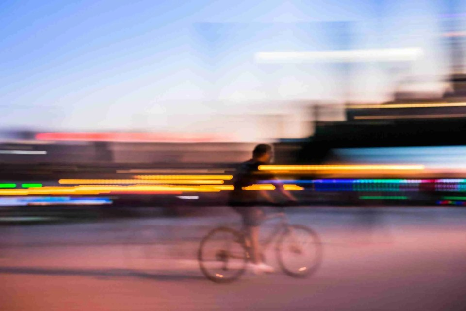 a panning shot of a bicyclist