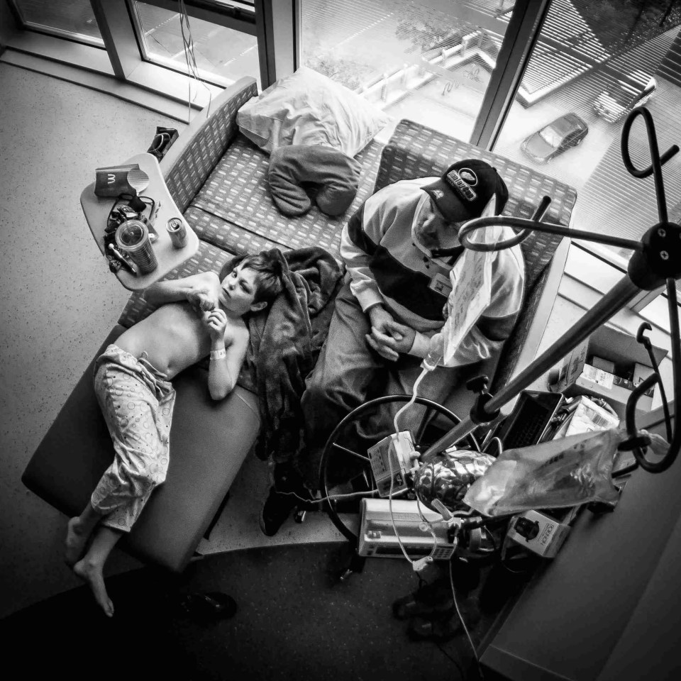 a boy and his dad in a hospital room