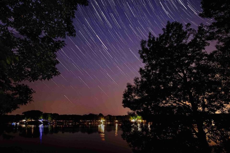 Star trails over a small lake in Michigan
