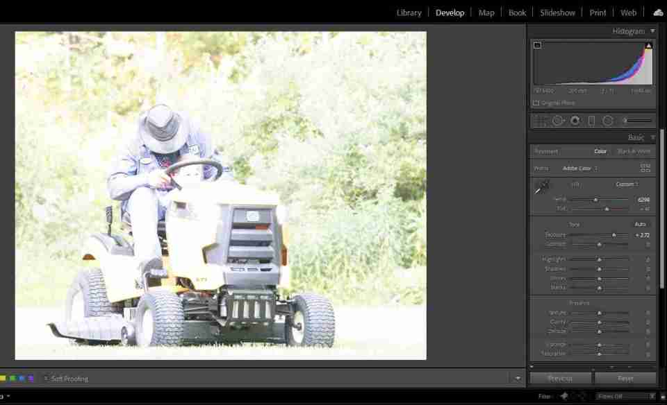 calculating exposure helps avoid overexposed images like this one with a grandpa on a tractor