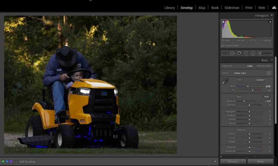 calculating exposure helps avoid dark images like this one with a grandpa on a tractor
