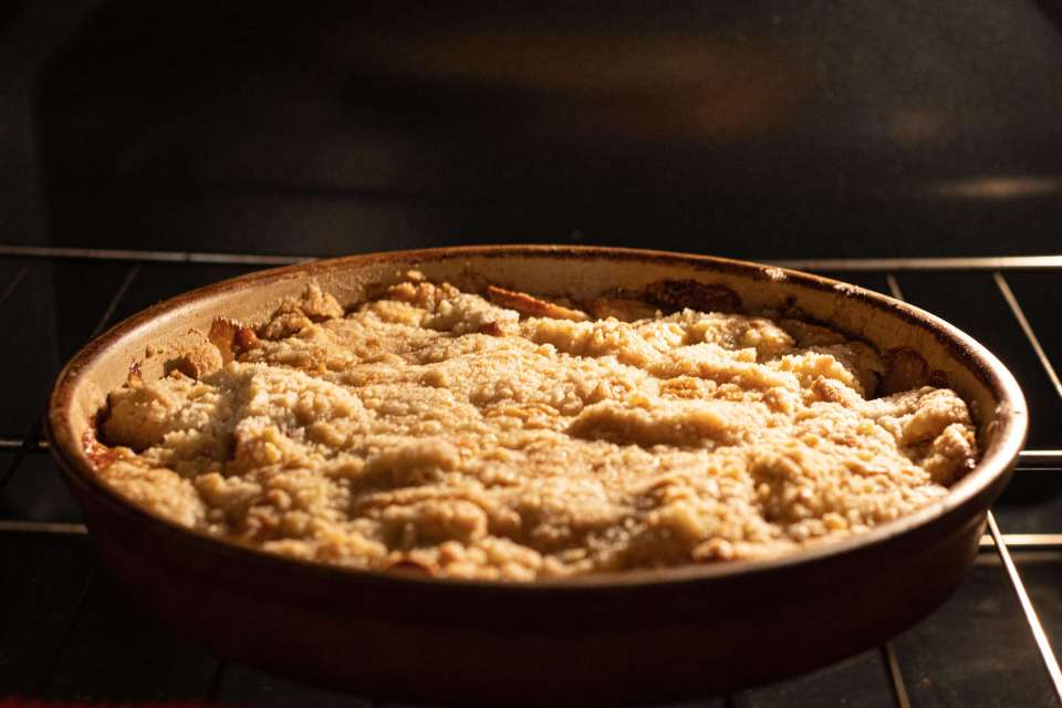 a fully baked apple crisp in the oven