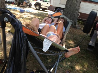 Three people and a jug of water in one hammock is probably not a recipe for good dreaming.