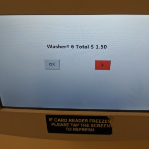 """a touchscreen menu that confirms the machine type and number, with a small """"ok"""" button on the left hand side"""