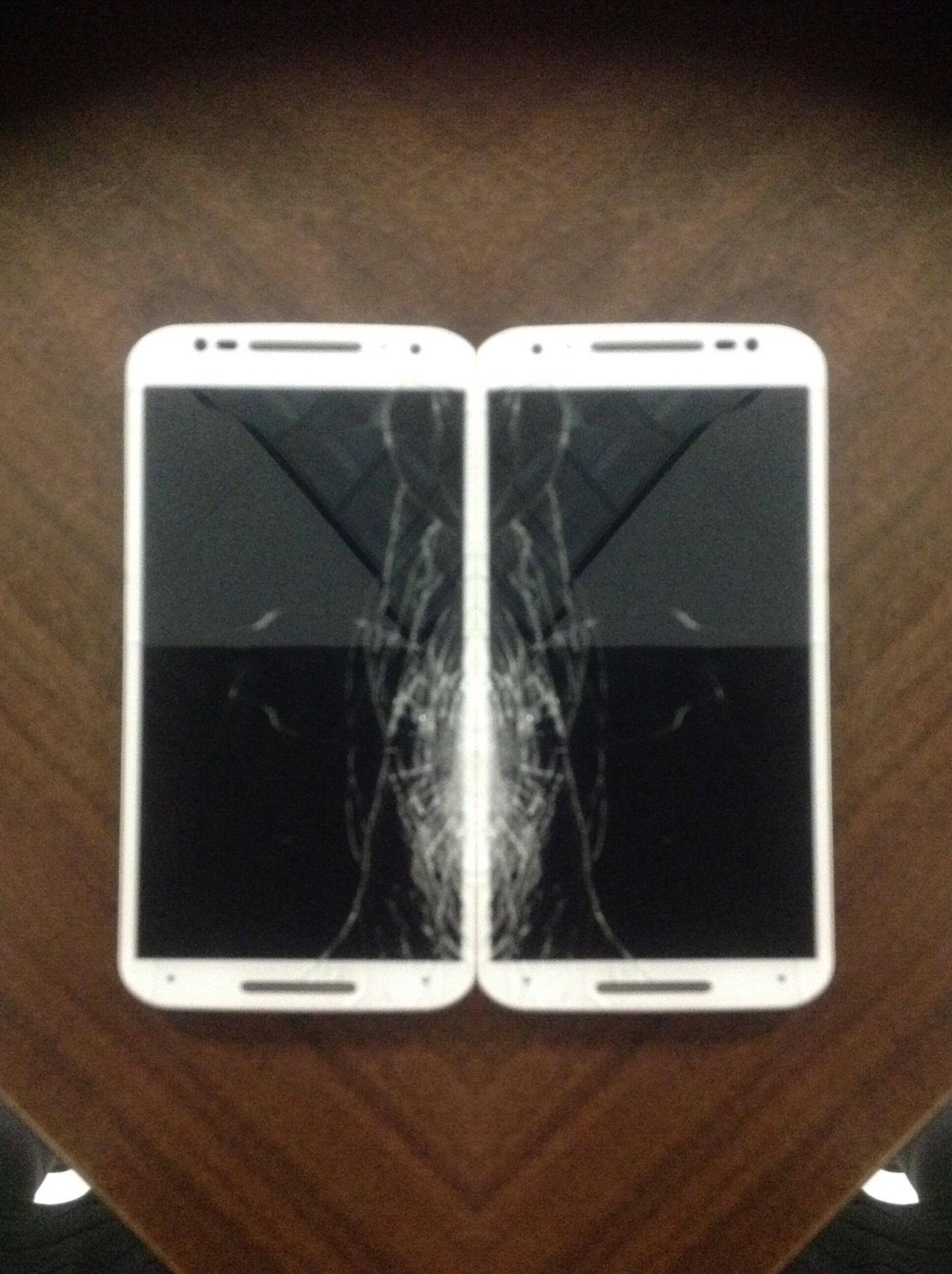 A double image of white phones