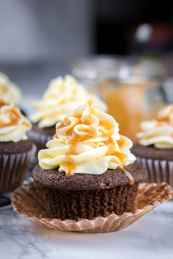 Chocolate Cupcakes with Caramel Filling and Vanilla Buttercream Frosting are moist and decadent mini cakes that you can make from scratch.