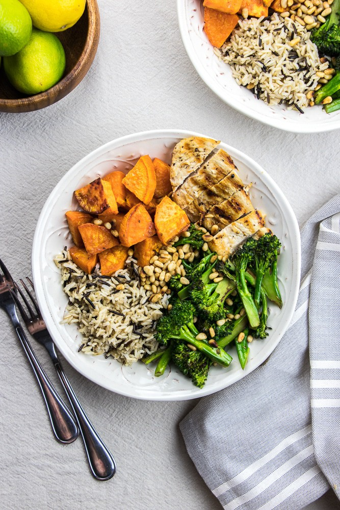 Buddha Bowl with sweet potatoes, wild rice, grilled chicken and broccolini is a great recipe that is easy to make. It is a perfect healthy dinner idea for busy weeknights.