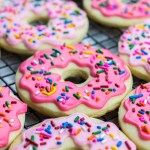 Donut Sugar Cookies topped with icing and sprinkles are the best recipe for soft cut out sugar cookies made from scratch!