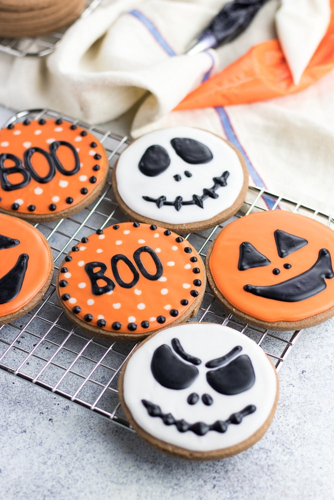 Halloween Chocolate Sugar Cookies are classic soft cut out sugar cookies made with cocoa powder and decorated with easy sugar icing!