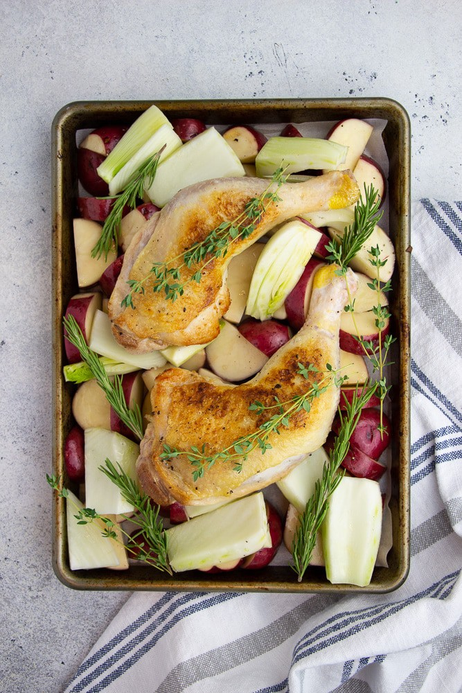 Oven roasted Chicken Legs with Potatoes and Fennel is an easy dinner idea for two. This one pan dish is Whole 30 and Gluten Free!