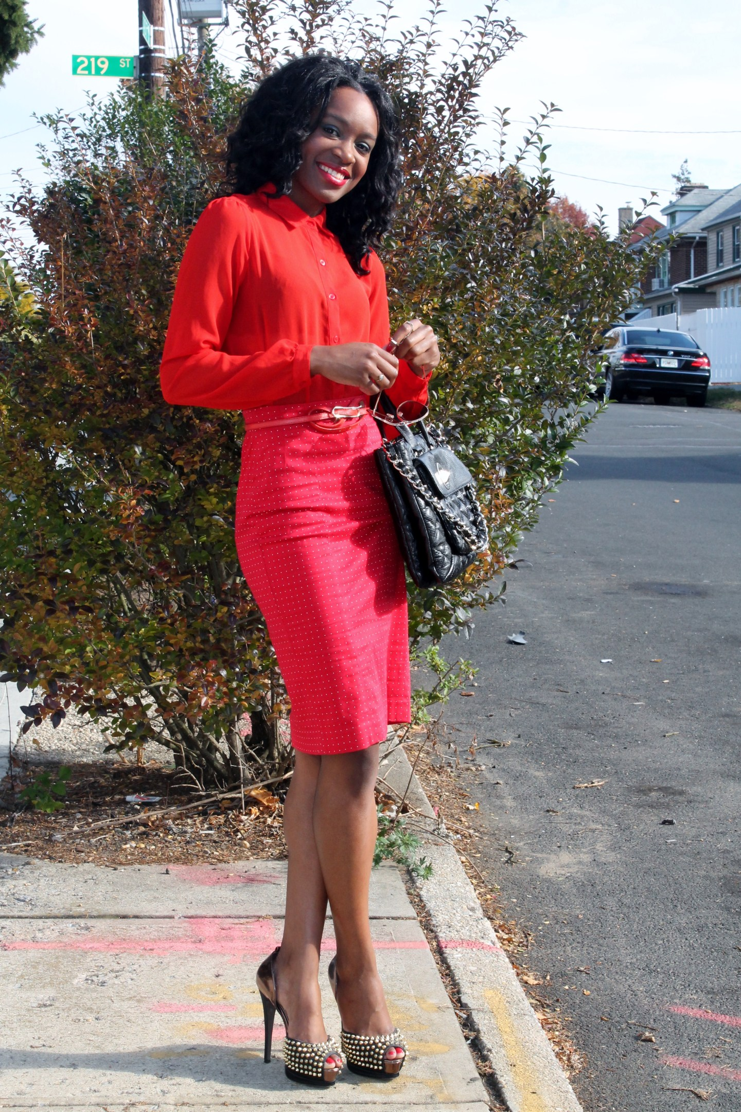 all red outfit, polka dot skirt, sheer blouse