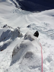 climbing through a very iced up section of Aoraki Mt cooks summit rocks