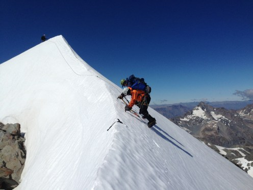 Down climbing from the summit of Alymer