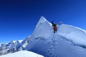 A narrow precarious summit