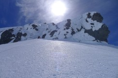 Climbing to the base of the summit gully - 1 pitch of Water ice 2 followed by 120m of 55 degree ice.