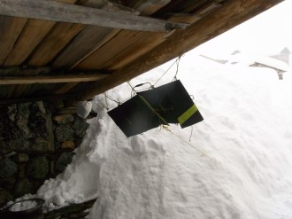 An attempt to get the Goal Zero system charged - despite the snow and cloud we were still able to charge the system!