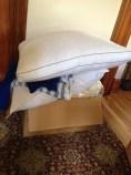 A box full of bedding, warm clothing, socks, etc.