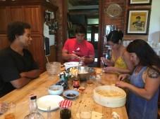 Eating while making dumplings