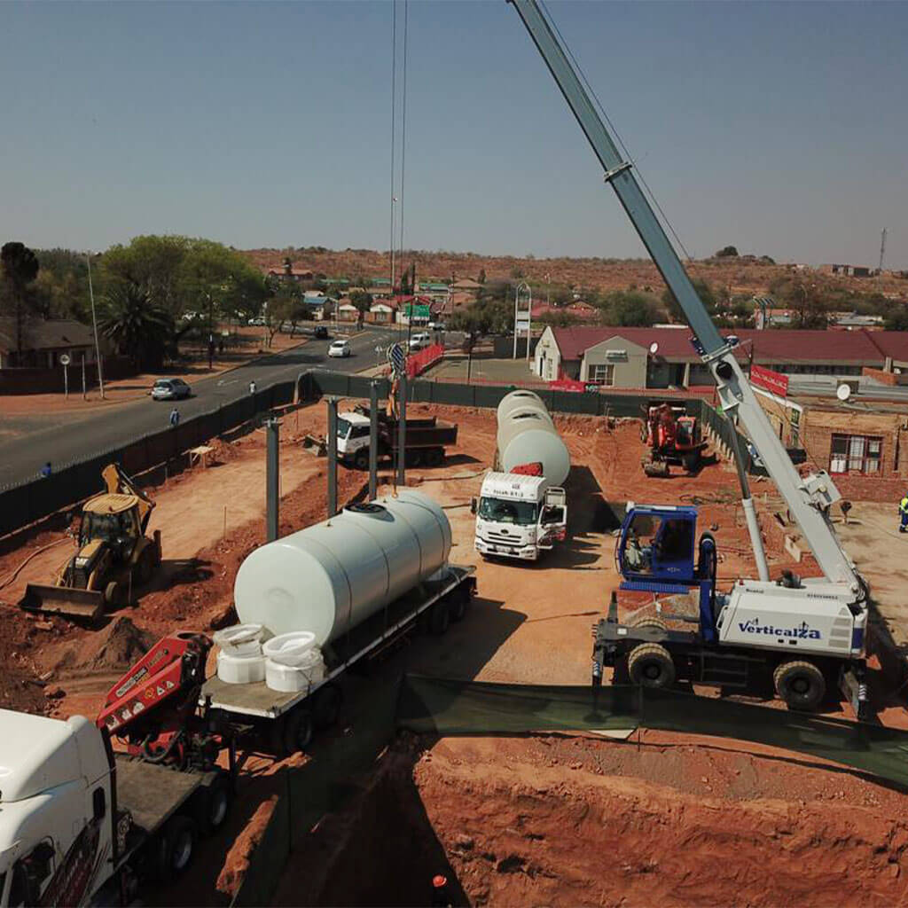 Fuel tank transport with crane and truck